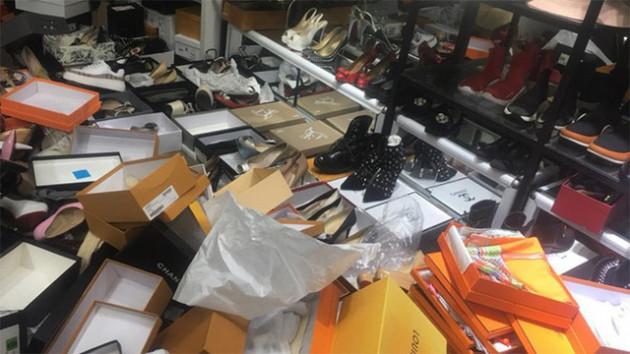 Hà Nội thu giữ hàng nghìn sản phẩm giả mạo thương hiệu nổi tiếng - Ảnh 1.